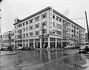 """Ackroyd 01599-1. """"Neon Sign Service. Joe Fisher's showrooms on W. Burnside at 14th, June 27, 1949."""" This building was demolished to make room for the I-405 stadium freeway."""