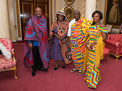 (left to right) High Commissioner of Lesotho Dr. John Oliphant and his wife Mrs Oliphant and High Commissioner of Ghana Papa Owusu-Ankomah and his wife Augustina at Buckingham Palace, London, following private audiences with Queen Elizabeth II.