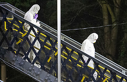 © Licensed to London News Pictures. 04/01/2019. Horsley, UK. Forensics officers cross the footbridge at Horsley Railway station in Surrey where a man has been stabbed to death on a train. A murder investigation has been launched after the man was attacked while on board the 12. 58pm train service travelling between Guildford and London Waterloo. . Photo credit: Peter Macdiarmid/LNP