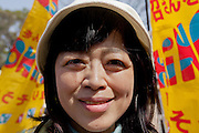 Akiko Hoshino, the wife of jailed activist, Fumiaki Hoshino who was arrested in 1975 for the alleged killing of a police officer during riots in Tokyo and sentenced to life imprisonment, at an anti-war and left wing demonstration in Shibuya, Tokyo, Japan Saturday March 20th 2010