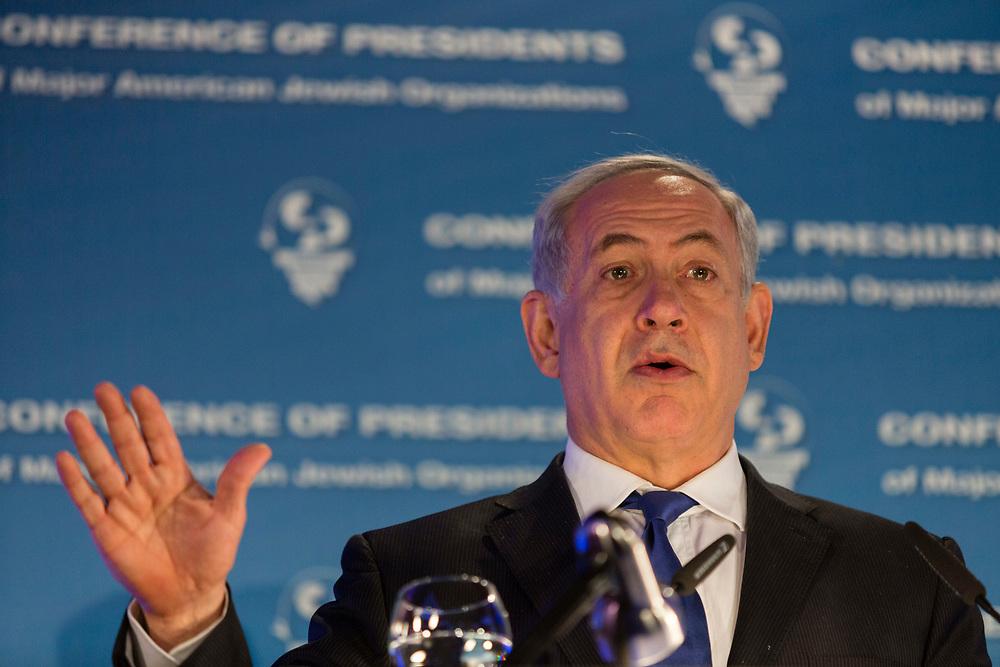 Israel's Prime Minister Benjamin Netanyahu gestures as he speaks during the Conference Of Presidents of Major American Jewish Organizations in Jerusalem, Israel, on February 17, 2014.