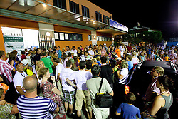 Fans outside the court wait for Jelena Jankovic of Serbia when she retired with an injury of her left ankle in her match  against Anastasiya Yakimova of Belarus  at 2nd Round of Singles at Banka Koper Slovenia Open WTA Tour tennis tournament, on July 22, 2010 in Portoroz / Portorose, Slovenia. (Photo by Vid Ponikvar / Sportida)