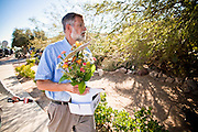 tucsonshooting - 11 JANUARY 2011 - TUCSON, AZ: An employee of Inglis Florists delivers flowers Tuesday to the home of the alleged shooter in the mass shooting in Tucson.  ARIZONA REPUBLIC PHOTO BY JACK KURTZ mass shooting Gabrielle Giffords shooting