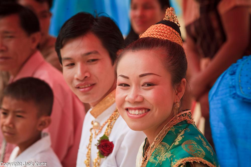 Mar. 14, 2009 -- LUANG PRABANG, LAOS: A newly wed couple greets guests at their wedding reception north of Luang Prabang, Laos. Photo by Jack Kurtz / ZUMA Press