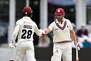 Tom Abell of Somerset and James Hildreth of Somerset touch gloves during the Specsavers County Champ Div 1 match between Somerset County Cricket Club and Essex County Cricket Club at the Cooper Associates County Ground, Taunton, United Kingdom on 23 September 2019.
