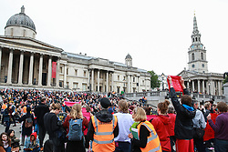 London, UK. 11 June, 2019. Activists from Extinction Rebellion disrupt the Royal Opera House BP Big Screen's Romeo and Juliet event in Trafalgar Square in protest against oil sponsorship of the arts. Activists at the 'Petroleo and Fueliet' protest highlighted the contradiction between the Government and Greater London Authority having declared a climate emergency and BP being given a platform to sponsor the Royal Opera House event in the heart of London.