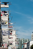 Shanghai, China - April 7, 2013: clothesline on building at the city of Shanghai in China on april 7th, 2013