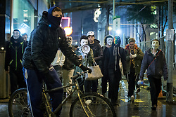 © Licensed to London News Pictures . 05/11/2015 . Manchester , UK . Protesters wearing Guy Fawkes masks at an Anonymous demonstration through Manchester , UK , this evening (5th November 2015) . Photo credit : Joel Goodman/LNP