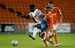 Coventry City's Jordy Hiwula (left) and Blackpool's Jay Spearing battle for the ball