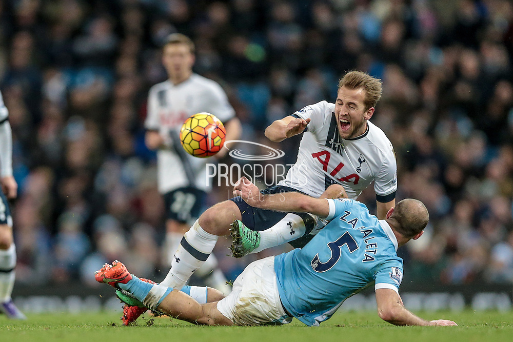 Harry Kane (Tottenham Hotspur) is fouled by Pablo Zabaleta (Manchester City) during the Barclays Premier League match between Manchester City and Tottenham Hotspur at the Etihad Stadium, Manchester, England on 14 February 2016. Photo by Mark P Doherty.