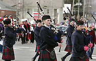 Goshen, New York - Girls in a pipe and drum band wear traditional dress while marching in the mid-Hudson St. Patrick's Day parade on March 13, 2011. ©Tom Bushey / The Image Works