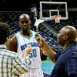 December 14, 2011; New Orleans, LA, USA; New Orleans Hornets center Emeka Okafor (50) is interviewed by reporters during Media Day at the New Orleans Arena.   Mandatory Credit: Derick E. Hingle-US PRESSWIRE