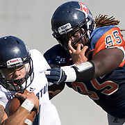 Fullerton College, quarterback Jordan Hoy (1), breaks a tackle from Orange Coast College defensive lineman, Keith Ford (95) during a CCCAA football game in Costa Mesa, California on November 5.<br /> Photo by Rachel Lacey Noll, Sports Shooter Academy