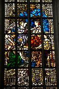 De Nieuwe Kerk is een kerkgebouw in Amsterdam. De kerk is gelegen aan de Dam, naast het Paleis op de Dam.De Nieuwe Kerk wordt, sinds soeverein-vorst Willem in 1814 in deze kerk de eed op de grondwet aflegde, ook gebruikt voor de inzegening van koninklijke huwelijken en voor inhuldigingen. De inhuldiging van Koningin Beatrix vond er plaats op 30 april 1980. Op dezelfde datum in 2013 zal de inhuldiging van haar zoon en opvolger Willem-Alexander ook daar plaatsvinden.<br /> <br /> The New Church is a church building in Amsterdam. The church is located on Dam Square, next to the Palace on the Dam.De New Church in this church in 1814, since sovereign-prince Willem laid aside the oath to the Constitution, also used for the blessing of royal weddings and inaugurations. The inauguration of Queen Beatrix took place on April 30, 1980. On the same date in 2013, the inauguration of her son and heir Willem-Alexander will also take place there.<br /> <br /> Op de foto / On the photo: Glas in Lood raam met Koningin Wilhelmina // Stained Glass window with Queen Wilhelmina