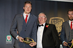 CARDIFF, WALES - Tuesday, November 8, 2016: Goalkeeper Wayne Hennessey is presented with a special blue Euro 2016 cap by FAW President David Griffiths during the FAW Awards Dinner at the Vale Resort. (Pic by David Rawcliffe/Propaganda)