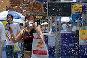 Fake snow on the street on  a hot day as Kirin drinks company has a promotional drive on the streets of Shanghai, China.