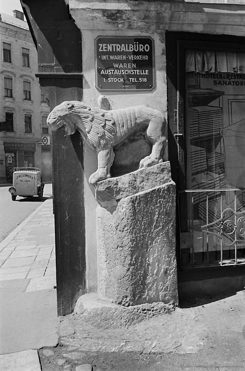 Lion sculpture and city, Klagenfurt, Austria, 1937