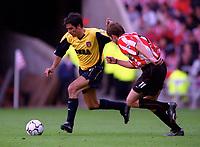 Robert Pires (Arsenal) takes on Kevin Kilbane (Sunderland). Sunderland 1:0 Arsenal. FA Premiership,19/8/2000. Credit Colorsport / Stuart MacFarlane.