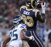 Football - NFL- Seattle Seahawks at St. Louis Rams.St. Louis Rams wide receiver Brian Quick (83) leaps to make a catch from the quarterback in the second quarter as he's shadowed by Seattle Seahawks cornerback Richard Sherman (25) at the Edward Jones Dome in St. Louis.  The Rams defeated the Seahawks, 19-13.