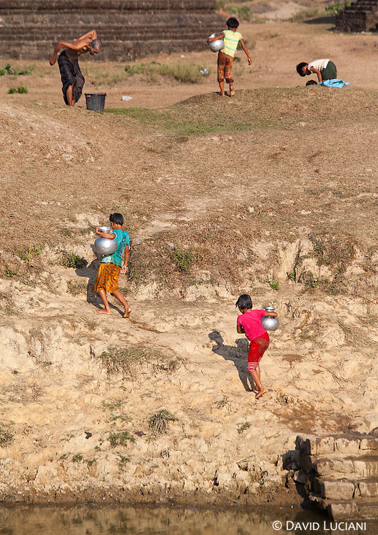 Girls getting water from a water reservoir in Mrauk U.