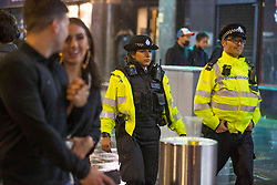 Licensed to London News Pictures. 03/10/2020. London, UK. Police patrol the streets while the revellers make their way home on Saturday night in Soho, central London - after the 10pm curfew early closing of pubs and bars. Photo credit: Marcin Nowak/LNP