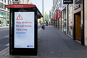 At the beginning of the fourth week of the UK government's lockdown during the Coronavirus pandemic, and with 120,067 UK reported cases with 16,060 deaths, a digital ad telling Londoners to stay at home is displayed on Oxford Street that would normally be a busy thoroughfare for shoppers and traffic and which remains largely deserted at mid-day, on 20th April 2020, in London, England.