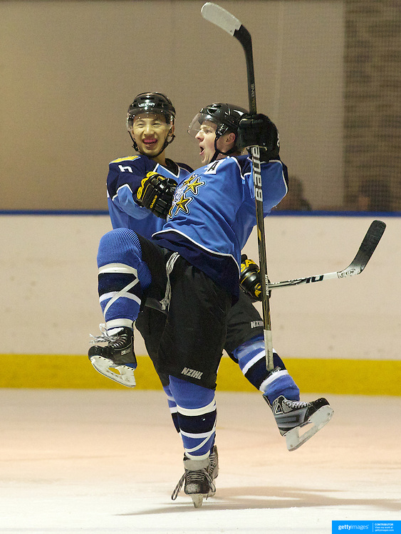 Blake Jackson, (right) celebrates after scoring for West Auckland Admirals with team mate Yin Man Chan during the Southern Stampede V West Auckland Admirals New Zealand Ice Hockey League match at the Queenstown Ice Arena. Southern Stampede won the match 9-8.  Queenstown, South Island, New Zealand, 5th June 2011