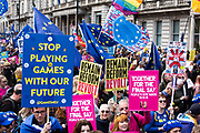 Protest signs and EU flags in the streets of London. Over an million people gathered together in the streets of London to march to parliament and protest against Brexit.