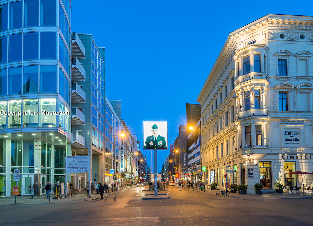 Night view of Checkpoint Charlie in Berlin Germany