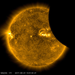 Image of the Moon transiting across the Sun, taken by SDO in 171 angstrom extreme ultraviolet light on August 21, 2017.<br /> <br /> Credit: NASA/SDO  Please note: Fees charged by the agency are for the agency's services only, and do not, nor are they intended to, convey to the user any ownership of Copyright or License in the material. The agency does not claim any ownership including but not limited to Copyright or License in the attached material. By publishing this material you expressly agree to indemnify and to hold the agency and its directors, shareholders and employees harmless from any loss, claims, damages, demands, expenses (including legal fees), or any causes of action or allegation against the agency arising out of or connected in any way with publication of the material.