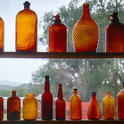 Aging amber bottles on display at the Turquoise Mining Museum and Trading Post in Cerrillos, NM.