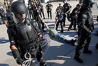 A war activist is dragged away after refusing to cooperate with U.S. Capitol Police when he was arrested for climbing over a barricade. Thousands of protestors of the wars in Iraq and Afghanistan converged into D.C. to march from the White House to the U.S. Capitol, where hundreds of people were arrested for civil disobedience and trespassing.