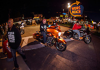 Bikes head into Weirs Beach Friday evening of Bike Week.  (Karen Bobotas/for the Laconia Daily Sun)