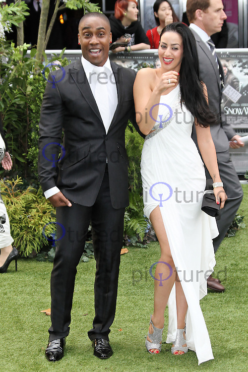 LONDON - MAY 14: Simon Webbe; Maria Kouka attend the World Film Premiere of 'Snow White And The Huntsman' at the Empire Cinema, Leicester Square, London, UK. May 14, 2012. (Photo by Richard Goldschmidt)