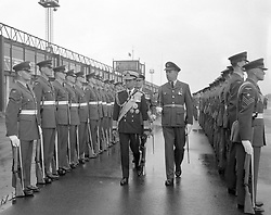 King Bhumibol Aduladej of Thailand in naval uniform, inspects a Royal Air Force guard of honour at Gatwick Airport on his arrival for a State visit to London.