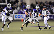 MANHATTAN, KS - OCTOBER 17:  Wide receiver Brandon Banks #83 of the Kansas State Wildcats returns the opening kick-off of the second half 97-yards for a touchdown against the Texas A&M Aggies on October 17, 2009 at Bill Snyder Family Stadium in Manhattan, Kansas.  (Photo by Peter G. Aiken/Getty Images)