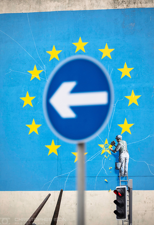 What next for Brexit??<br /> A road sign indicates one-way from Banksy's famous Brexit mural on the side of a derelict building in Dover. <br /> Prime Minister Theresa May is meeting European leaders today to ask for an extension in the hope of avoiding a no-deal Brexit. <br /> Picture date Wednesday 10th April, 2019.<br /> Picture by Christopher Ison. Contact +447544 044177 chris@christopherison.com