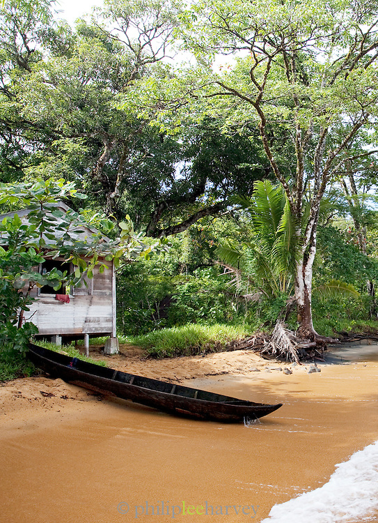 A dugout canoe next to a fishermans hut on the island reserve of Nosy Mangabe, Madagascar