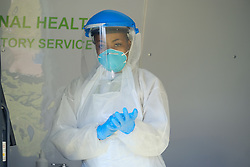 JOHANNESBURG, SOUTH AFRICA - MAY 08: A health worker prepares in a mobile NHLS testing lab at a Diepsloot COVID-19 screening and testing site at Diepsloot Sarafina Park on May 08, 2020 in Johannesburg, South Africa. Reports claim that in Diepsloot more than 12 000 people have been screened with over 1000 people tested. The Premier urged the people of Diepsloot to continue practicing safety measures including social distancing and wearing cloth masks when leaving home. (Photo by Dino Lloyd)