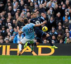Tottenham Hotspur's Kyle Walker and Manchester City's Sergio Aguero go for the ball - Photo mandatory by-line: Dougie Allward/JMP - Tel: Mobile: 07966 386802 24/11/2013 - SPORT - Football - Manchester - Etihad Stadium - Manchester City v Tottenham Hotspur - Barclays Premier League