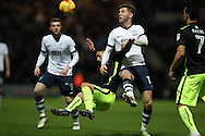 Preston North End midfielder Paul Gallagher (12) drags down Brighton & Hove Albion winger Anthony Knockaert (11) during the EFL Sky Bet Championship match between Preston North End and Brighton and Hove Albion at Deepdale, Preston, England on 14 January 2017.