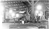 """D&RGW Durango roundhouse interior with #476 undergoing repairs.<br /> D&RGW  Durango, CO  Taken by Morse, Ron - 1960<br /> In book """"Durango: Always a Railroad Town (1st ed.)"""" page 45"""