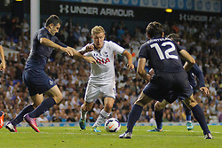 29.08.2013, White Hart Lane, London, ENG, UEFA CL Qualifikation, Tottenham Hotspur vs FC Dinamo Tiflis, Rueckspiel, im Bild Tottenham's Lewis Holtby takes on 3 defenders during the UEFA Europa League Qualifier second leg match between Tottenham Hotspur and FC Dinamo Tiflis Zuerich at the White Hart Lane in London, England on 2013/08/29 . EXPA Pictures © 2013, PhotoCredit: EXPA/ Mitchell Gunn <br /> <br /> ***** ATTENTION - OUT OF GBR *****