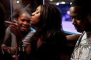 LaShay Caldwell (from left), Ashley Brooks and David Tatum at the Halo Bar in St. Louis.