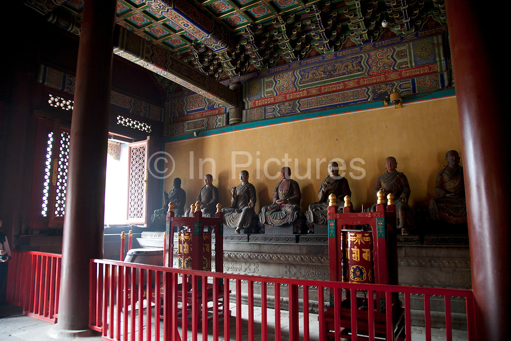 "Interior at one of the main buildings at Yonghe Temple, also known as the ""Palace of Peace and Harmony Lama Temple"", the ""Yonghe Lamasery"", or - popularly - the ""Lama Temple"" is a temple and monastery of the Geluk School of Tibetan Buddhism located in the northeastern part of Beijing, China. It is one of the largest and most important Tibetan Buddhist monasteries in the world. The building and the artworks of the temple is a combination of Han Chinese and Tibetan styles."