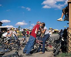 teenagers kissing at a motorcross game