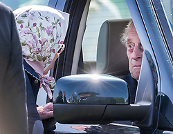 © Licensed to London News Pictures. 11/05/2018. Windsor, UK. Queen Elizabeth II talks to the Duke of Edinburgh as he remains in a car during the 75th Royal Windsor Horse Show. This is the first time that the Duke has been seen in public since his hip operation last month. The five day event takes place in the grounds of Windsor Castle. Photo credit: Peter Macdiarmid/LNP