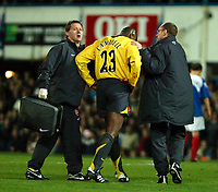 Photo: Ed Godden.<br />Portsmouth v Arsenal. The Barclays Premiership. 12/04/2006. Arsenal's Sol Campbell leaves the field with a cut face.