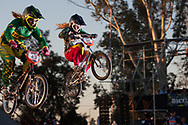 # 43 (QUINALHA Bianca) BRA jumps the first jump while  # 171 (O'KEEFFE Teagan) RSA hangs of for dear life during the first practice round at the UCI BMX Supercross World Cup in Santiago del Estero, Argintina.