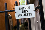Entree des artistes sign in the French Quarter along Church Street in historic Charleston, SC.